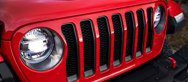 Iconic 7-slot grille & lights on a Jeep Wrangler