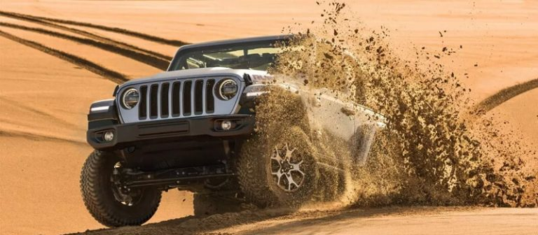 Jeep Wrangler off-roading on sand