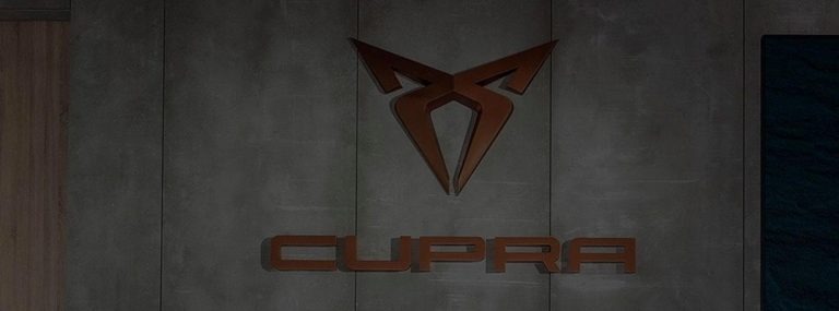 CUPRA logo on concrete wall